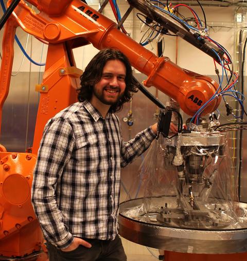 Robot programmerar om sig själv under drift