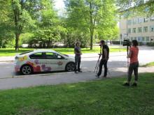Artister för Miljön kör elbilen Opel Ampera