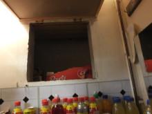 Op Batmobile - hole behind wall cupboard in Stoke shop NW04/15