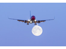Norwegian 737-800 aircraft moon image