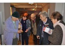 Visitors using the audioguide at the John Gray Centre