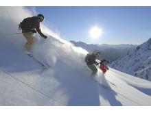 3 skiløbere i fart