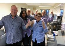 Fornøyde medarbeidere i Reklame-huset.no, med Olav Granly, eier og daglig leder i front