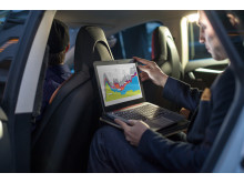 Man using HP EliteBook Folio 1020 G1 Special Edition in car