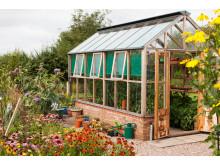 Planthouse 8 i cederträ med bröstning i tegel