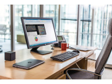 Executive Desk with the HP Elite x2 1011 G1, HP Wireless Docking Station and the HP EliteDisplay E271i