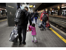At Rome main train station, Termini, Hasan * walks with his daughter Elin * after have been sent back to Italy from Austri