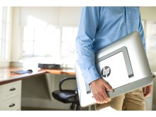 Man carrying the HP ENVY ROVE 20 Mobile All-in-One from home office
