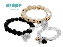 Dråpe - rocka armbånd med hodeskaller i fargene sort og hvitt/brunt