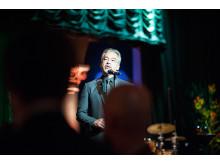 Alfons Karabuda talar på SKAP:s vårfest 2014