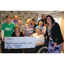 "Care scheme residents' ""grand"" gift to Macmillan"