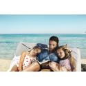 Hver tredje kvinde er lykkeligst på ferien