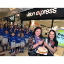 Special guest of honour and local football team celebrate Vision Express Irvine's one year anniversary