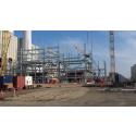 Kæmpe kraftværksombygning tager form