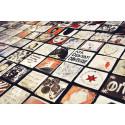 """Kakelplattor fyllda med självporträtt, ordspråk och reliefer, gjorda av elever på Vårbyskolan i Huddinge i Skapande Skola-projektet """"Att sätta spår""""."""