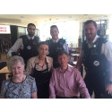 The Druces with the officers and staff who came to Mr Druce's aid