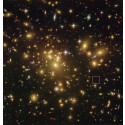 Location of the galaxy A1689-zD1 behind the galaxy cluster Abell 1689