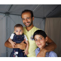 A Syrian family inside a Better Shelter in Karatepe transit camp, Mytilini, Lesvos, Greece