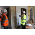 Cllr's McConachie (left) and Murdoch inspecting the interior of the new apartments
