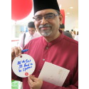 National Day Rally Event - Participant posing with his wish for Singapore at the National Day Rally Event