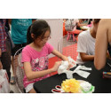 SG50 Roadshow - Girl learning how to make recycled flowers