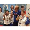 Svenska simlaget tar 2 guld, ett silver och ett brons i 100 meter frisim under Special Olympics World Summer Games