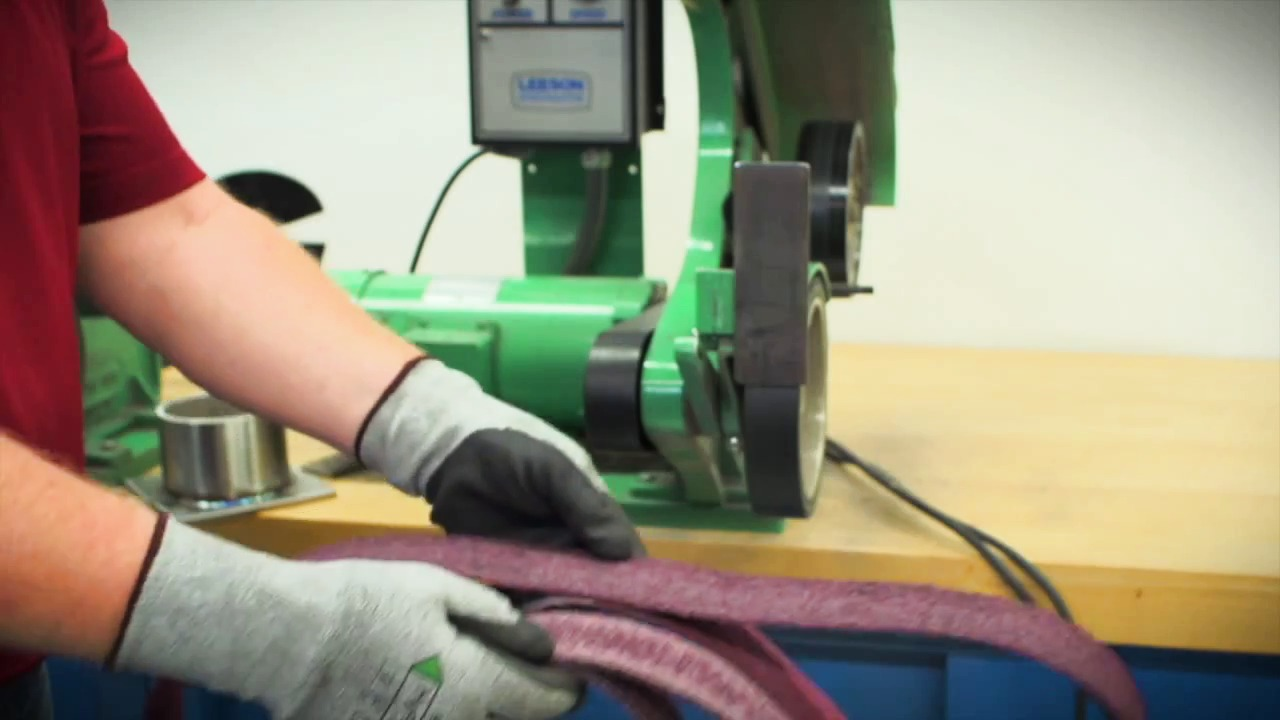 Norton BearTex RapidPrep belts on benchstand machine
