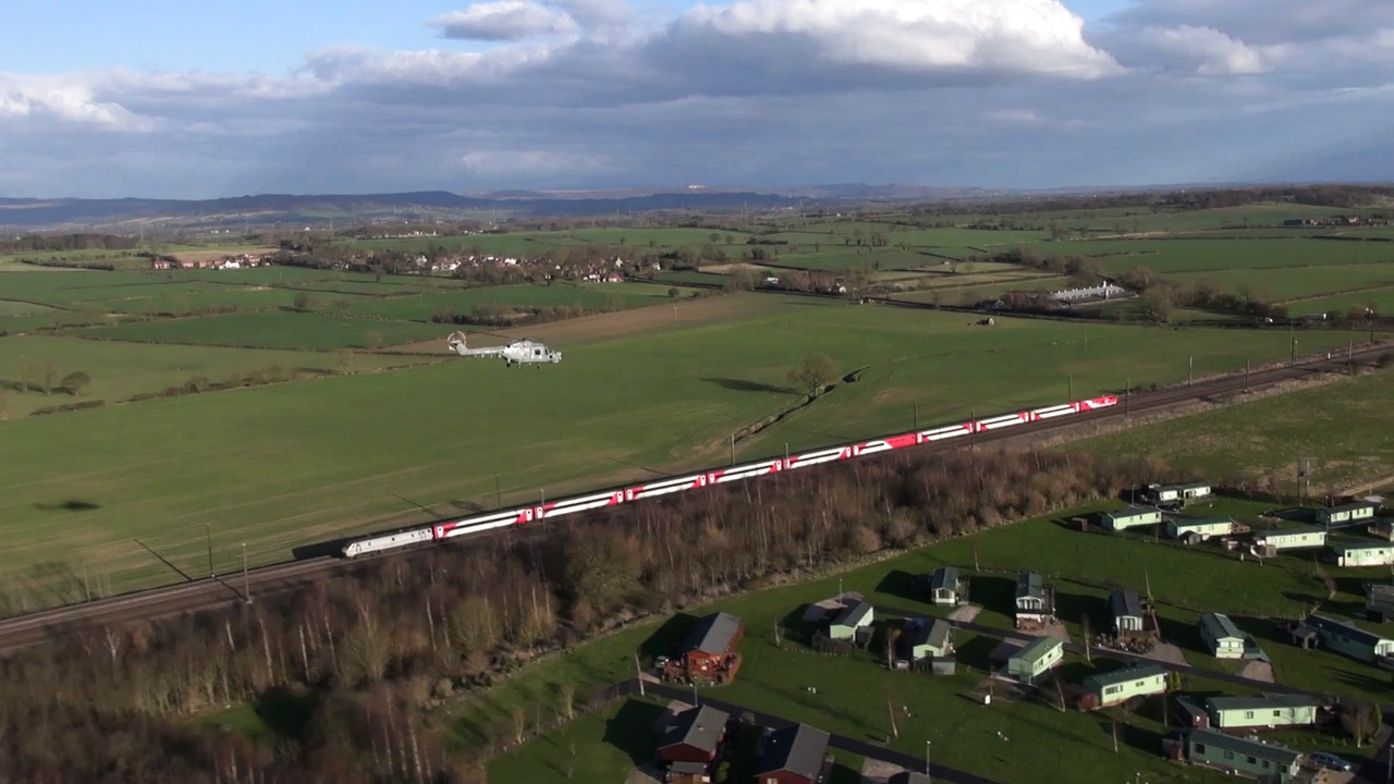 VIRGIN TRAINS EAST COAST TRAIN ESCORTED BY ROYAL NAVY LYNX HELICOPTERS
